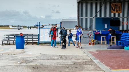 aerodrome: Seville, Spain - May 7, 2016: Group of skydivers preparing for jumping event. Skydive Spain preparation area. Skydive Spain is the skydiving center located at La Juliana Aerodrome, about 20 km southwest of Seville, Spain. At Skydive Spain they fly up to 1