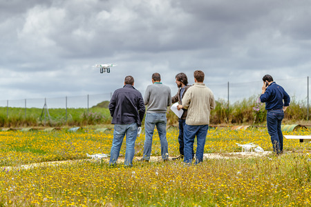 Seville, Spain - May 7, 2016: Group of persons making drone training course at La Juliana  Aerodrome. Skydive Spain is the skydiving center located at  La Juliana Aerodrome, about 20 km southwest of Seville, Spain. At Skydive Spain they fly up to 15,000ft