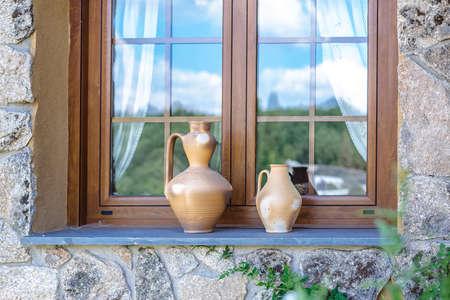 ledge: Rustic vases on window ledge. Outdoor design