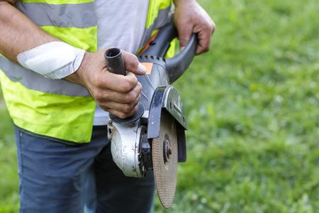 grinder machine: Injured worker hand with grinder machine
