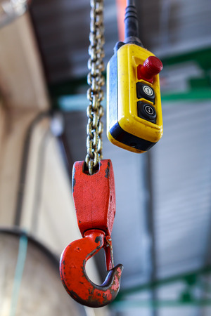 hoists: Close up of electrical control panel and Industrial crane Hook