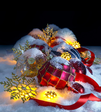 Christmas ornaments in the snow. Night christmas scene Stock Photo