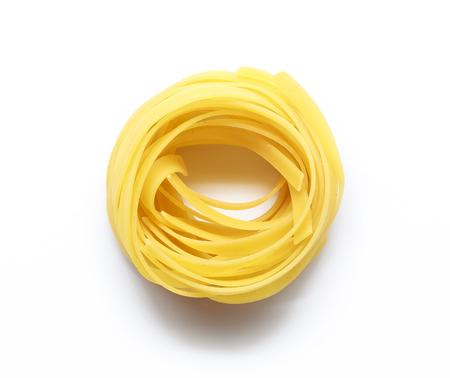 macarrones: Tagliatelle italian pasta isolated on white background