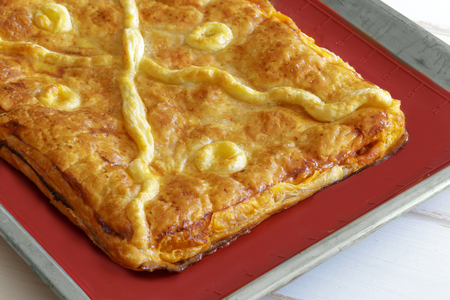 Baked traditional pie stuffed with vegetables and tuna fish, Galician pie.