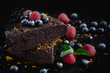 Delicious chocolate cakes on black background.