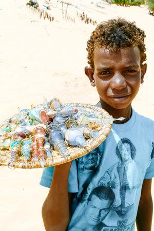 Aswan, Egypt  - August 19, 2006:  Egyptian boy sells glass bottles with desert sand. At least 16.7 million children live in poverty in Egypt Editorial