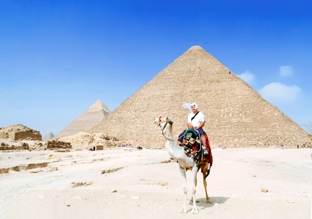 Man tourist riding on camel in Egypt desert