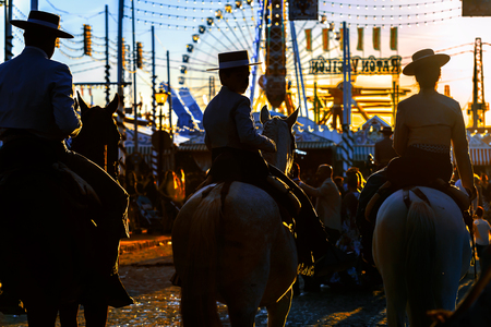 Silhouette of Horse riders at sunset. Seville's April Fair. Spanish Culture