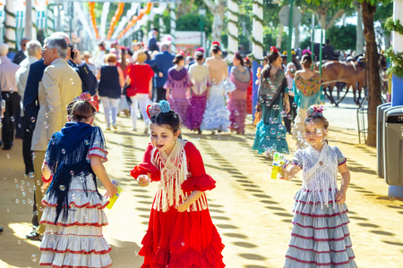 Seville, Spain - May 02, 2017: Little girls playing with soap bubbles at the Seville's April Fair.
