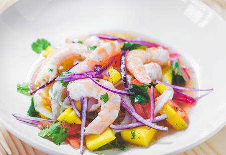 Refreshing dish of fish marinated in citrus juice. Shrimp and Mango Ceviche. Diet and healthy food concept Stock Photo