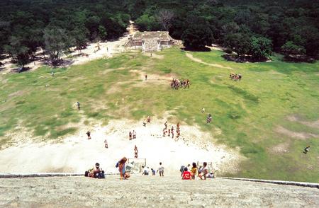 Climbing the pyramid at Chitchen Itza, Yucatan, Mexico Stock Photo