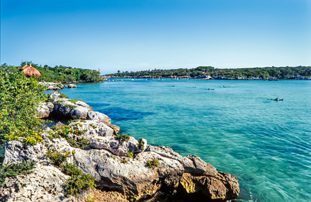 Beautiful bay with turquiose waters and rocky coastline of Xel Ha, Cancun, Mexico