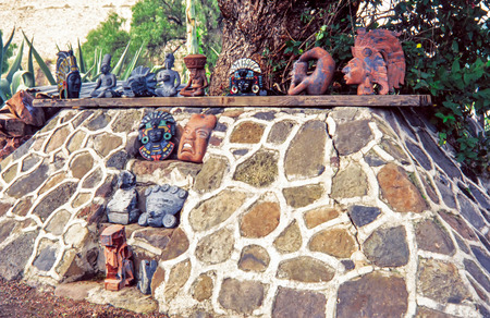 MEXICO CITY, MEXICO - AUGUST 12, 1998: Local aztec souvenirs made of various materials. Today, ceramics are still produced from traditional items such as dishes, kitchen utensils to new items such as sculptures and folk art.