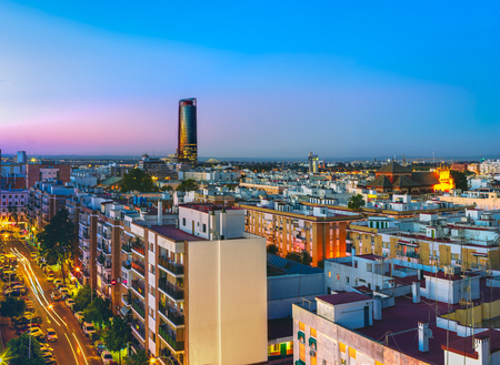Sevilla Tower at night. View from the traditional neighborhood of Triana in Seville, Spain.
