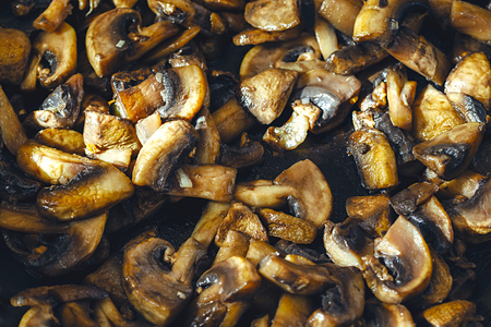Delicious and healthy fried Mushroom champignon with olive oil, onion, garlic and chilli.