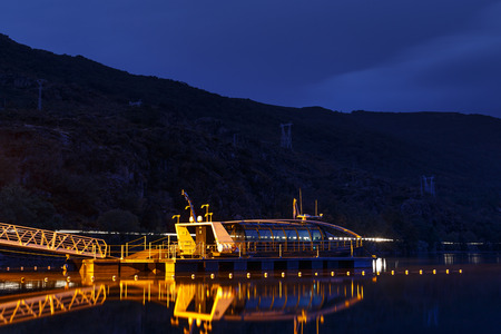 Night view of Sanabria Lake and enviromental cruise powered by alternative energy. Zamora, Spain. Stock Photo