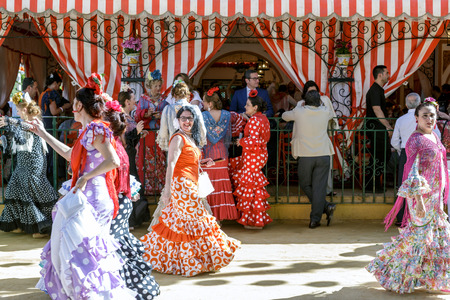 Seville, Spain - May 03, 2017:  People taking a walk and enjoying at the Seville's April Fair. Redakční