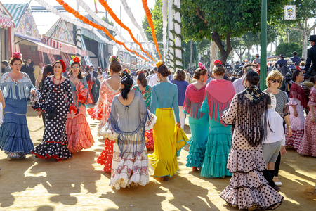 Seville, Spain - May 03, 2017:  Young Women dressed in traditional costumes at the Seville's April Fair. Foto de archivo - 97410272