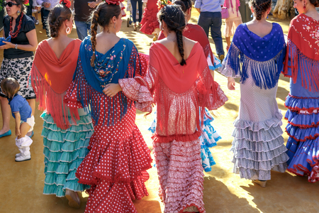 Seville, Spain - May 03, 2017:  Young Women dressed in traditional costumes at the Sevilles April Fair.