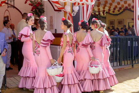 Seville, Spain - May 03, 2017:  Beautiful andalusian young women dressed in traditional costumes at the Seville's April Fair. Foto de archivo - 97410283