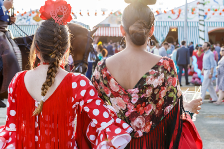 Seville, Spain - May 03, 2017: Women dressed in traditional costumes at the Seville's April Fair. Foto de archivo - 97410419