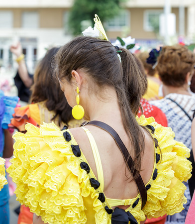 Seville, Spain - May 04, 2017:  Young Woman wearing traditional Sevillana dresses at the Seville April Fair. The Feria de Abril has a history that dates back to 1857 and takes place a fortnight after Easter each year. The origin of the fair was a cattle m Foto de archivo - 108846204