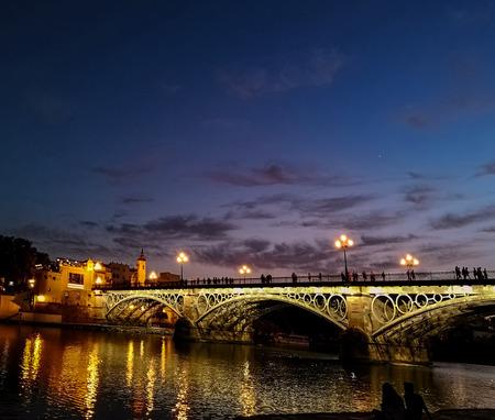 Triana bridge (Bridge of Isabel II) over the river Guadalquivir, Sevilla, Andalucia, Spain