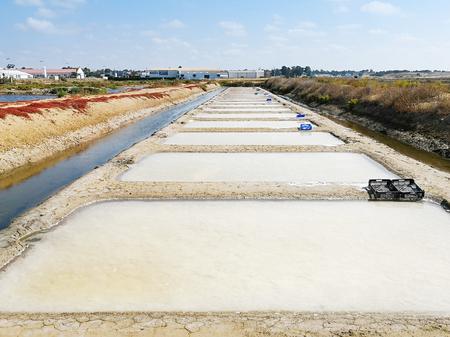 Traditional saltworks. Isla Cristina, Huelva, Spain. Deposits sediments, canals and mud flats. Southern Andalusia saltworks.