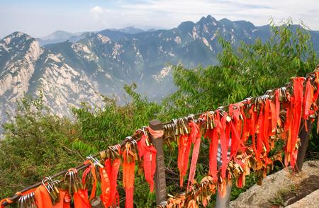 Gold padlocks and red ribbons on the sacred Huashan mountain.