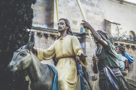 Jesus Christ riding on a donkey on palm sunday (easter week).