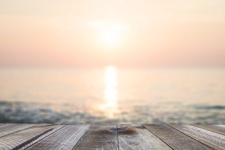 Wooden free space on table with beautiful sunset beach over the sea