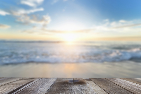 Empty wooden table with blue sea and sand beach