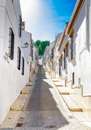 Beautiful Street in Estepa, province of Seville. Charming white village in Andalusia. Standard-Bild - 121821061
