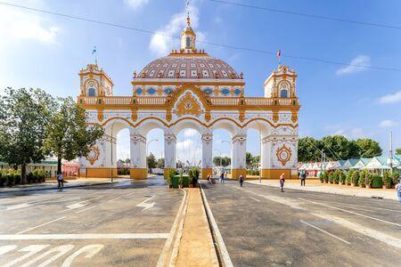 Front view of Entrance arch (Portada) to the April Fair ((Feria de Abril) at morning, Seville Fair (Feria de Sevilla), Andalusia, Spain