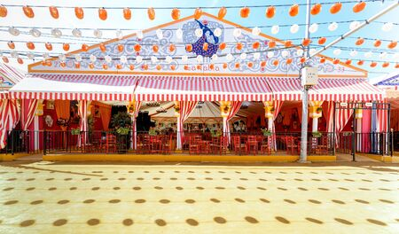 "Panoramic view of Beautiful decorated Caseta ""fair tent"" at the April Fair ((Feria de Abril), Seville Fair (Feria de Sevilla), Andalusia, Spain"
