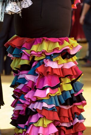 Woman wearing flamenco dress. Detail of Traditional and colorful Spanish flamenco dress