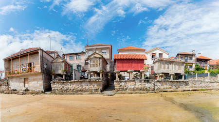 Horreos, Traditional Galician Granary in Fishing village of Combarro. Stock Photo - 150732757