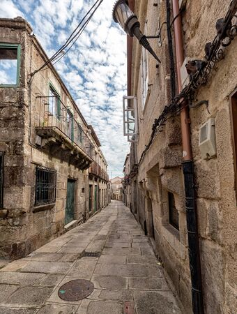 Strolling through the medieval streets of Tui. Tourism in Galicia. The most beautiful spots in Spain. Declared a Historic Artistic Site Stock Photo