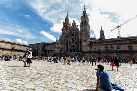 Santiago de Compostela, Spain - August 20 2019: Pilgrims and tourists in the Plaza del Obradoiro.. The Plaza del Obradoiro is the largest of its kind in the whole of Galicia and it becomes the center point for the 25th July Saint James day.