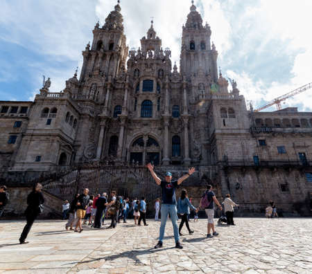 Santiago de Compostela, Spain - August 20 2019: Pilgrims and tourists in the Plaza del Obradoiro.. The Plaza del Obradoiro is the largest of its kind in the whole of Galicia and it becomes the center point for the 25th July Saint James day. Stock Photo - 150894798