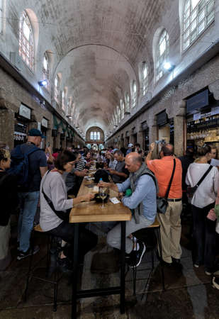 Santiago de Compostela, Spain - August 20 2019: Eating in The fresh food market in Santiago de Compostela.The food market in the Old Town is the city's second most visited attraction after the cathedral and a must-see for food lovers.
