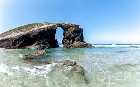 Natural arch in Cathedrals beach. Beautiful beach in Ribadeo. Tourism in Galicia. The most beautiful spots in Spain.