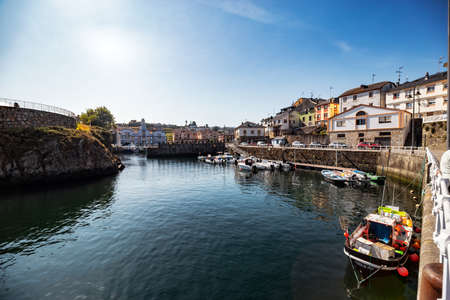 Puerto de Vega, Spain - August 23 2019: Beautiful and picturesque port in Puerto de Vega, Navia. It was awarded the title «Example town of Asturias» and chosen the most beautiful town in Asturias. Stock Photo - 151662617