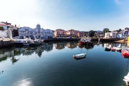 Puerto de Vega, Spain - August 23 2019: Beautiful and picturesque port in Puerto de Vega, Navia. It was awarded the title «Example town of Asturias» and chosen the most beautiful town in Asturias.