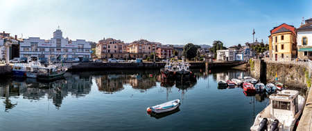 Puerto de Vega, Spain - August 23 2019: Beautiful and picturesque port in Puerto de Vega, Navia. It was awarded the title «Example town of Asturias» and chosen the most beautiful town in Asturias. Stock Photo - 151900462
