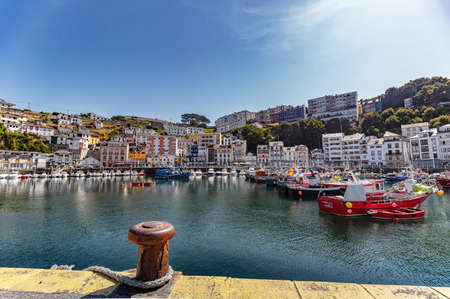 Luarca, Spain - August 23 2019: Colorful Fishery Harbor. Luarca. Asturias. Luarca is well known for its beautiful architecture, landscapes, gastronomy and tourist attractions. Stock Photo - 152054193