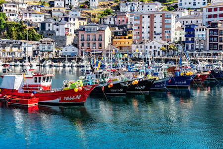 Luarca, Spain - August 23 2019: Colorful Fishery Harbor. Luarca. Asturias. Luarca is well known for its beautiful architecture, landscapes, gastronomy and tourist attractions.