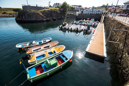 Puerto de Vega, Spain - August 23 2019: Beautiful and picturesque port in Puerto de Vega, Navia. It was awarded the title «Example town of Asturias» and chosen the most beautiful town in Asturias. Stock Photo - 152054184