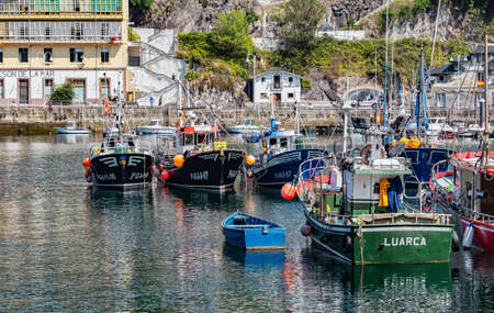 Luarca, Spain - August 23 2019: Colorful Fishery Harbor. Luarca. Asturias. Luarca is well known for its beautiful architecture, landscapes, gastronomy and tourist attractions. Stock Photo - 152054180