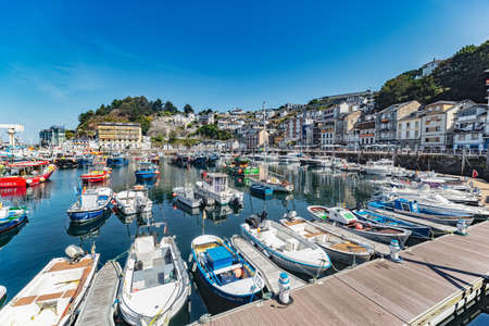 Luarca, Spain - August 23 2019: Colorful Fishery Harbor. Luarca. Asturias. Luarca is well known for its beautiful architecture, landscapes, gastronomy and tourist attractions. Stock Photo - 152054183